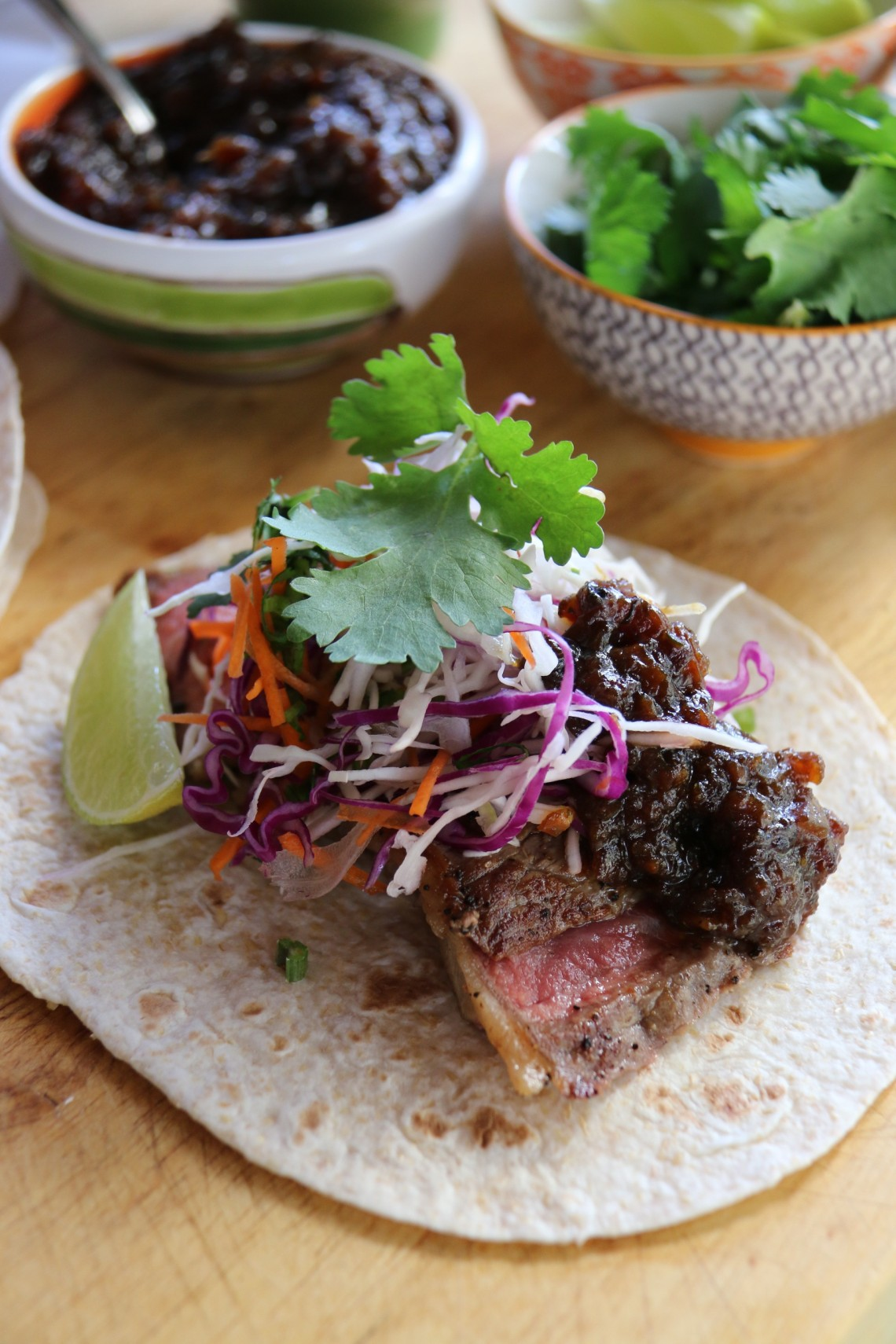Soft Tortillas with grilled, spiced, sirloin and ale and onion jam.